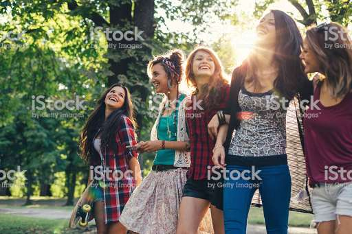 Group of teenage girls on a leisure walk in the park